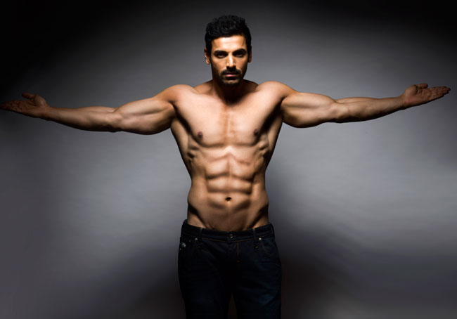 John Abraham is so hot on the cover of Maxim that we are drooling all over
