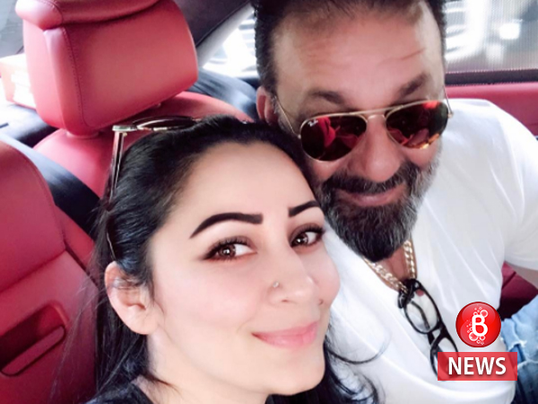 What are Sanjay Dutt and Maanayata Dutt up to in this picture?