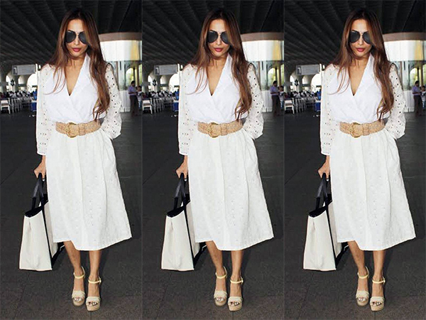 Ladies, put your hands up for our fashionista! Malaika Arora wows in a summery white dress at the airport