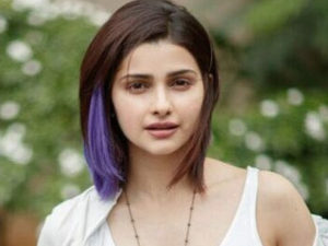 Prachi Desai adds a pop of purple to her short mane!