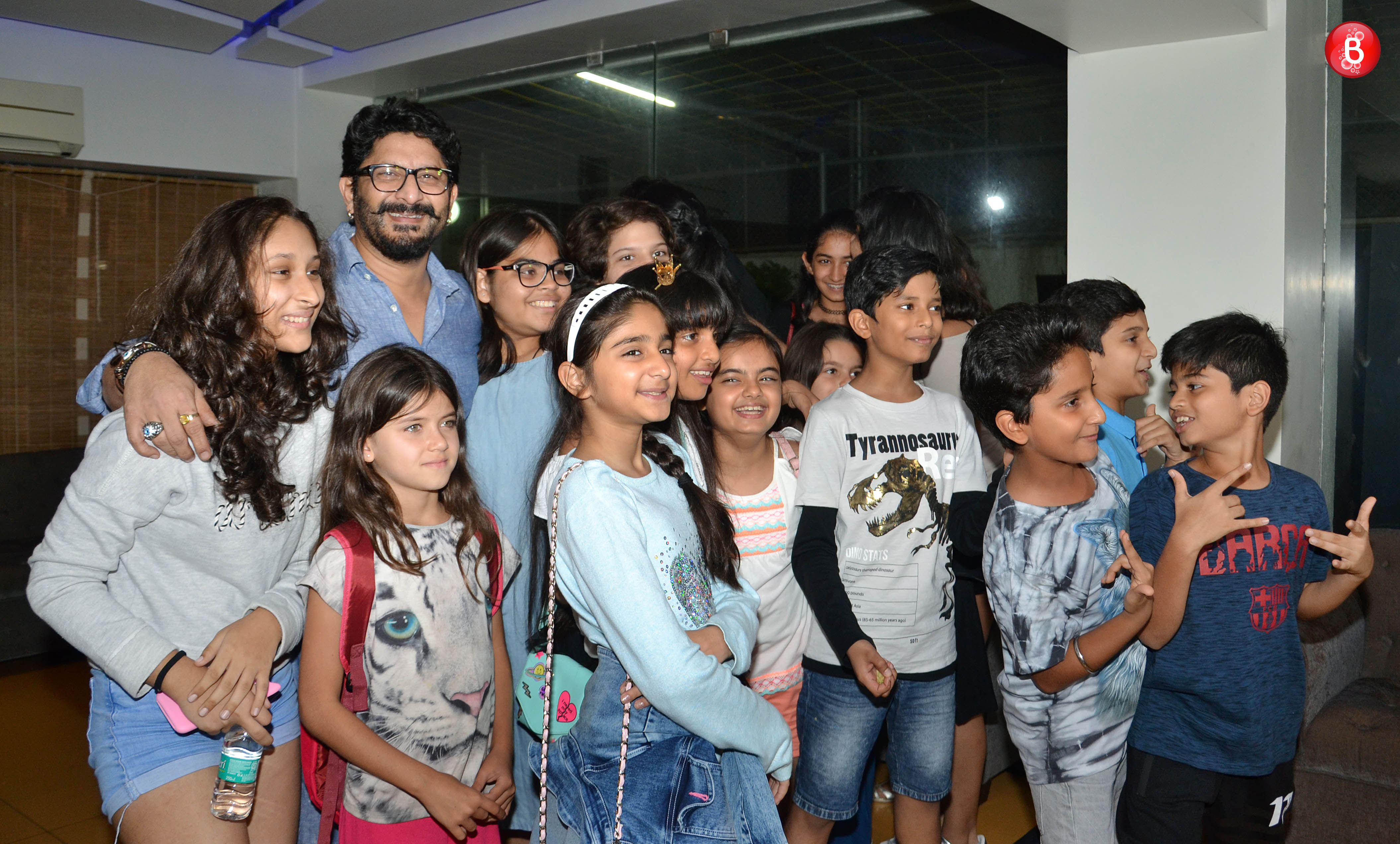 Arshad Warsi with a bunch of kids