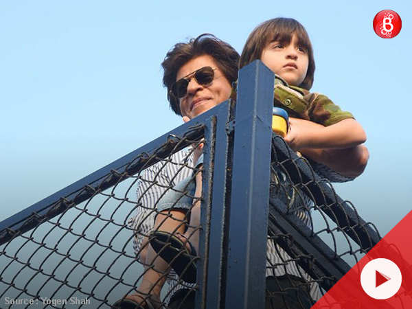 WATCH: Shah Rukh Khan and AbRam greet fans outside Mannat on his 52nd birthday