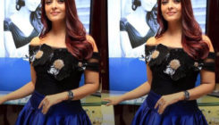 Trust us; we're clueless about why Aishwarya is wearing that cringe-worthy dress!