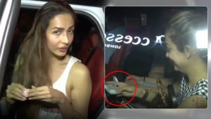Malaika Arora hand over money to beggars