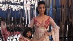 Aishwarya gives a kiss to Mickey Contractor, but Aaradhya's pout is unmissable, view pic
