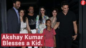 Akshay Kumar blesses a kid outside the Yauatcha in Mumbai
