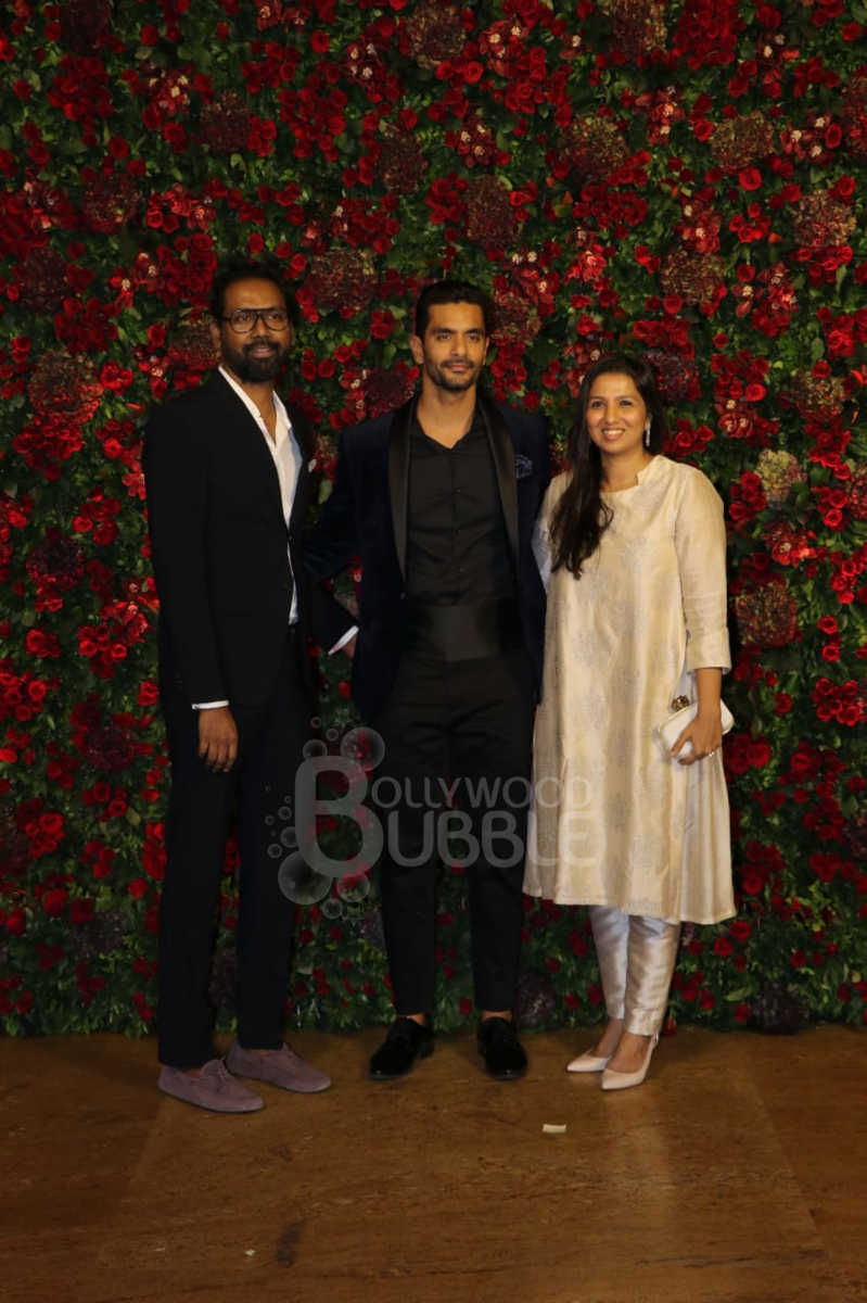 Angad Bedi with other guests