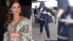 Is this Nargis Fakhri hiding her face from paparazzi?
