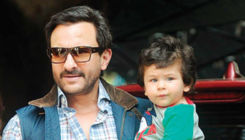 Taimur Ali Khan playing in the pool with daddy Saif Ali Khan - view pics