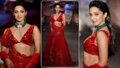 Kiara Advani stuns in a blood-red plunging neckline gown as she sizzles on the ramp