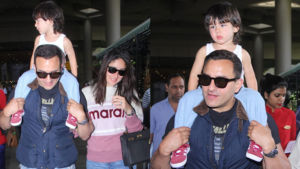Taimur greets the photographers as Saif-Kareena are back from their London vacay - view pics
