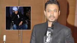 Irrfan Khan hides his face as he exits Mumbai airport on a wheelchair- view pics