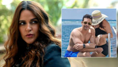 Angad Bedi poses with a woman in a black bikini; wifey Neha Dhupia asks,